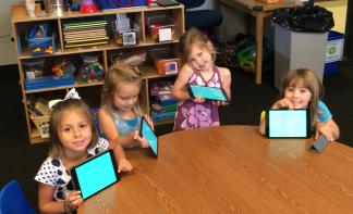 Preschoolers at KidsU at at University of Houston-Clear Lake with their iPads.