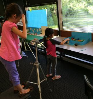 Young children at KidsU at University of Houston-Clear Lake create claymation with digital photography.