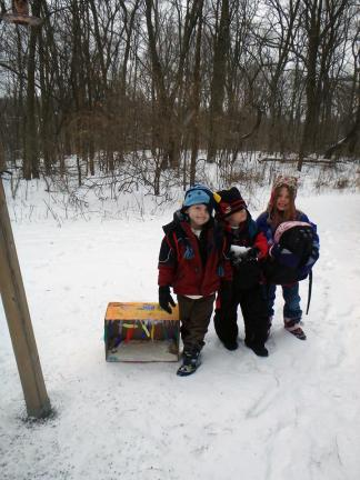 Children show off one of the bait boxes