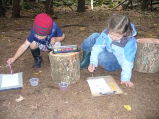 Wild Roots students journaling outdoors.